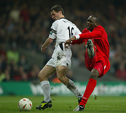 CARDIFF, WALES - Sunday, March 2, 2003: Liverpool's Emile Heskey under pressure from Manchester United's Roy Keane during the Football League Cup Final at the Millennium Stadium. (Pic by David Rawcliffe/Propaganda)