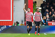 Neal Maupay (Brentford) celebrating his goal with Said Benrahma (Brentford) during the EFL Sky Bet Championship match between Brentford and Derby County at Griffin Park, London, England on 6 April 2019.