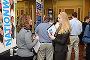 Ohio University student Leigh Oczkowski meets with a Nationwide representative at the Career Fair held on February 18, 2014.