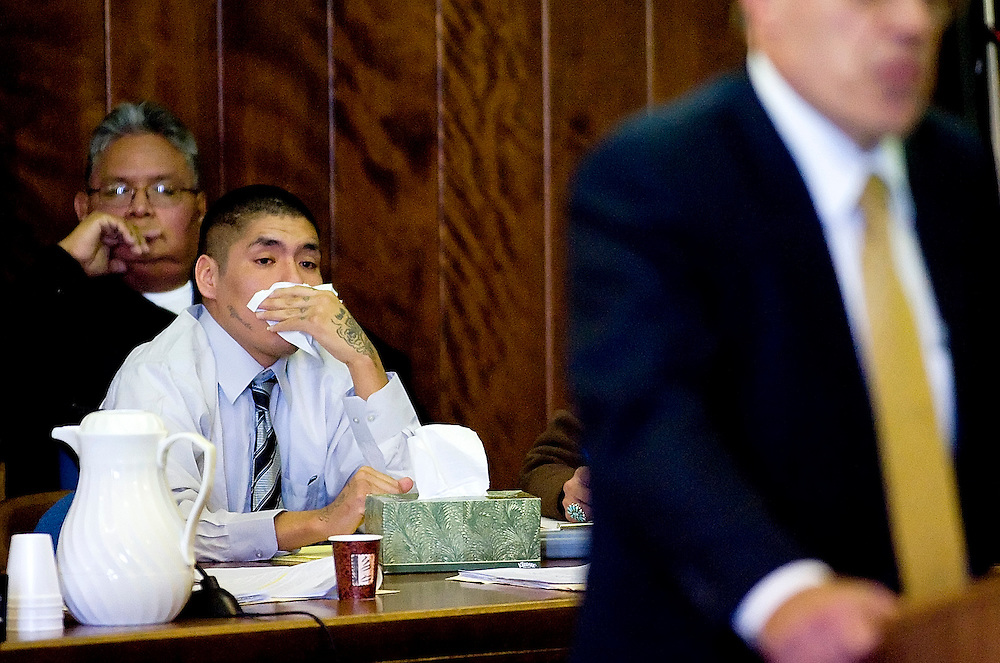 120108     Brian Leddy.Alvin Mariano holds a tissue to his face during the opening arguments of his trial on Tuesday at the McKinley County Courthouse. Alvin Mariano is accused of killing his wife, Olivia James-Mariano, in November of last year.