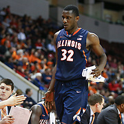 Nnanna Egwu #32 of the Illinois Fighting Illini high-fives his teammates on the bench during the NIT First Round game at Agganis Arena on March 19, 2014 in Boston, Massachusetts . (Photo by Elan Kawesch)