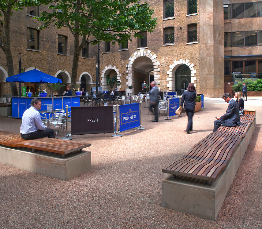 Devonshire square in the City of London with business workers during lunchtime