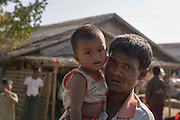 A father holds his son in his arms at the Takkay Pyin Camp near Sittwe. 2015-02-05.