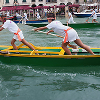 VENICE, ITALY - SEPTEMBER 04:  Women rowers on traditional Venetian boats take part in one of the races of the Historic Regata on September 4, 2011 in Venice, Italy. The Historic Regata is the most popular boat race on the Gran Canal for locals and tourists alike.