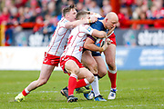 Leeds Rhinos loose forward Carl Ablett (12) is stopped by a number of Hull Kingston Rovers  players during the Betfred Super League match between Hull Kingston Rovers and Leeds Rhinos at the Lightstream Stadium, Hull, United Kingdom on 29 April 2018. Picture by Simon Davies.