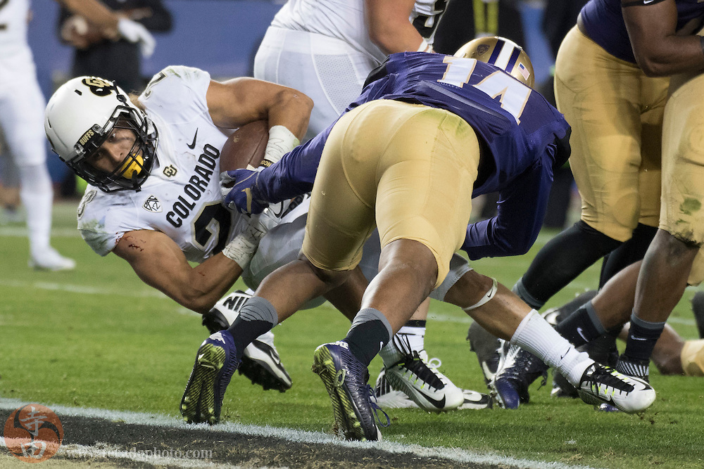 December 2, 2016; Santa Clara, CA, USA; Colorado Buffaloes running back Phillip Lindsay (23) scores a touchdown against Washington Huskies defensive back Jojo McIntosh (14) during the first quarter in the Pac-12 championship at Levi's Stadium.