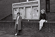 Female friends outside Southall police station, Southall, UK, 1985.
