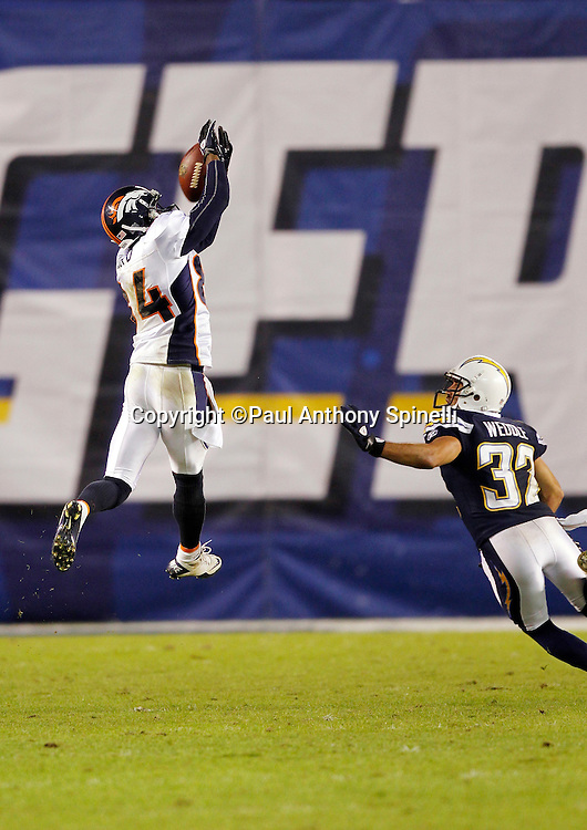 Denver Broncos wide receiver Brandon Lloyd (84) leaps while trying to catch an incomplete pass while covered by San Diego Chargers safety Eric Weddle (32) during the NFL week 11 football game against the San Diego Chargers on Monday, November 22, 2010 in San Diego, California. The Chargers won the game 35-14. (©Paul Anthony Spinelli)