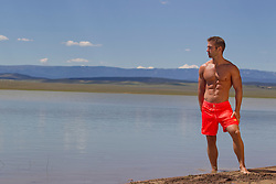 good looking man in a lake