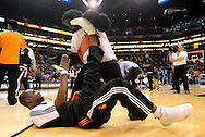 Feb. 17, 2011; Phoenix, AZ, USA; Phoenix Suns guard Mickael Pietrus (12) is stretched by the Phoenix Suns Gorilla prior to the game against the Dallas Mavericks at the US Airways Center. Mandatory Credit: Jennifer Stewart-US PRESSWIRE