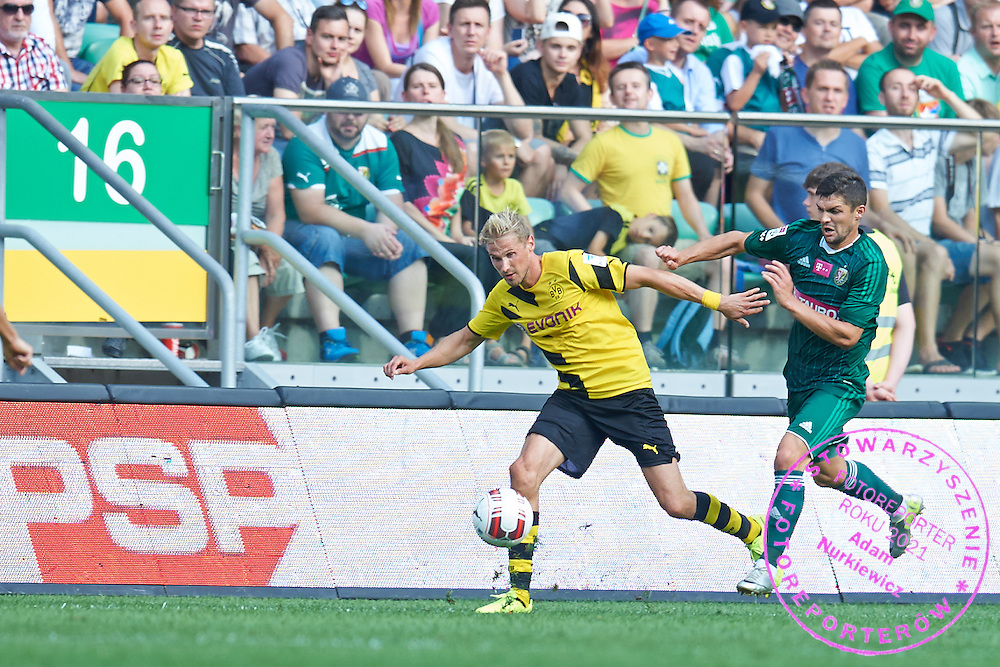 (L) Oliver Kirch of Dorussia Dortmund controls the ball during international friendly soccer match between WKS Slask Wroclaw and BVB Borussia Dortmund on Municipal Stadium in Wroclaw, Poland.<br /> <br /> Poland, Wroclaw, August 6, 2014<br /> <br /> Picture also available in RAW (NEF) or TIFF format on special request.<br /> <br /> For editorial use only. Any commercial or promotional use requires permission.<br /> <br /> Mandatory credit:<br /> Photo by &copy; Adam Nurkiewicz / Mediasport