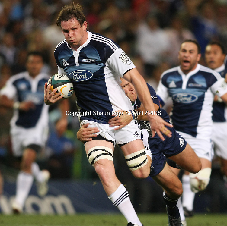 CAPE TOWN, SOUTH AFRICA - 28 February 2009: Josh Blackie is tackled by Peter Grant during the Super 14 match between the Vodacom Stormers and the Blues held at Newlands Stadium in Cape Town. Photo by: Shaun Roy/ SPORTZPICS