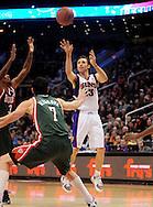 Feb. 2, 2011; Phoenix, AZ, USA; Phoenix Suns guard Steve Nash (13) makes a pass against the Milwaukee Bucks forward Ersan Ilysova (7) at the US Airways Center. The Suns defeated the Bucks 92-77. Mandatory Credit: Jennifer Stewart-US PRESSWIRE