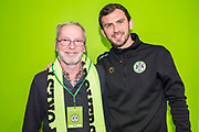 Forest Green Rovers Gavin Gunning(16) with his sponsor during the EFL Sky Bet League 2 match between Forest Green Rovers and Carlisle United at the New Lawn, Forest Green, United Kingdom on 16 March 2019.