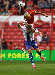 Tom Bradshaw of Walsall and Kelvin Wilson of Nottingham Forest (Top) in action - Mandatory byline: Jack Phillips / JMP - 07966386802 - 11/08/15 - FOOTBALL - The City Ground - Nottingham, Nottinghamshire - Nottingham Forest v Walsall - Football League Cup Round 1