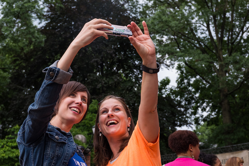 Participants pause for a selfie after the first ever OU Women Portrait on Tuesday, June 23, 2015. Over 300 women participated in the photo.  Photo by Ohio University  /  Rob Hardin