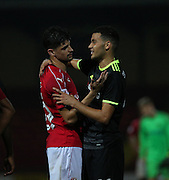 Swindon Raphael Rossi Branco (29) embraces Chelsea Jay Dasliva (48) at the end of the game. Swindon win 2-1.the EFL Trophy match between Swindon Town and U23 Chelsea at the County Ground, Swindon, England on 13 September 2016. Photo by Gary Learmonth.