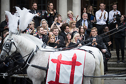 © Licensed to London News Pictures . 30/06/2017 . Stockport , UK . Mourners applaud outside the Town Hall after the service . The funeral of Martyn Hett at Stockport Town Hall . Martyn Hett was 29 years old when he was one of 22 people killed on 22 May 2017 in a murderous terrorist bombing committed by Salman Abedi, after an Ariana Grande concert at the Manchester Arena . Photo credit : Joel Goodman/LNP