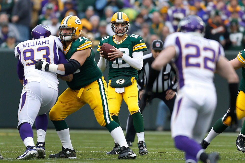 GREEN BAY, WI - DECEMBER 2:  Aaron Rodgers #12 of the Green Bay Packers drops back to pass during a game against the Minnesota Vikings at Lambeau Field on December 2, 2012 in Green Bay, Wisconsin.  The Packers defeated the Vikings 23-14.  (Photo by Wesley Hitt/Getty Images) *** Local Caption *** Aaron Rodgers