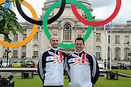 Welsh athletes Gareth Warburton, (left) selected for 800m and Brett Morse ®  , selected for discus event in the GB team for the London Olympics, pose for a picture outside Cardiff city Hall in Cardiff on 12/7/2012. pic by Andrew Orchard, Andrew Orchard sports photography,