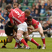 Twickenham, LONDON, Llanelli Scarlets, forwards combine to smuggle the ball, [left] no.5 Adam Jones [centre] Gavin Thomas handing the ball to Simon Easterby, during the  2006, Powergen Cup, between London Wasps vs Llanelli Scarlets, at the RFU Stadium, ENGLAND, 09.04.2006, 2006, , © Peter Spurrier/Intersport-images.com.   [Mandatory Credit, Peter Spurier/ Intersport Images].