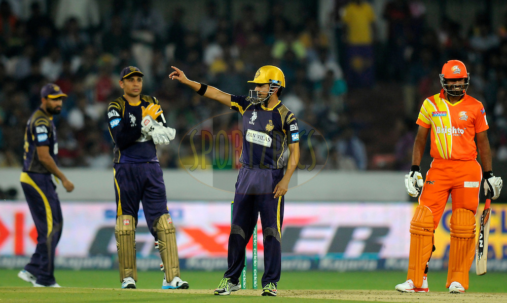 Gautam Gambhir captain of Kolkata Knight Riders sets the field during match 7 of the Oppo Champions League Twenty20 between the Kolkata Knight Riders and the Lahore Lions held at the Rajiv Gandhi Cricket Stadium, Hyderabad, India on the 21st September 2014<br /> <br /> Photo by:  Pal Pillai / Sportzpics/ CLT20<br /> <br /> <br /> Image use is subject to the terms and conditions as laid out by the BCCI/ CLT20.  The terms and conditions can be downloaded here:<br /> <br /> http://sportzpics.photoshelter.com/gallery/CLT20-Image-Terms-and-Conditions-2014/G0000IfNJn535VPU/C0000QhhKadWcjYs