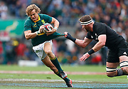 Andries Coetzee from South Africa (L) is tackled by Kieran Read from New Zealand (R) during the Rugby Championship test match between South Africa and New Zealand at Newlands Stadium in Cape Town, South Africa, 07 October 2016.