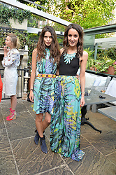 Left to right, SARAH ANN MACKLIN and ROSANNA FALCONER at a party to celebrate 'A Year In The Garden' celebrating the first year of The Ivy Chelsea Garden, 197 King's Road, London on 16th May 2016.