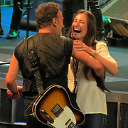 Bruce Springsteen  and daughter Jessica Springsteen during Dancing in the dark  in concert in Paris France,on July 5th 2012 at Palais Omnisports de Paris Bercy.