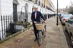 © Licensed to London News Pictures. 19/12/2012. London, UK. Former Conservative chief whip Andrew Mitchell is walking to work with his bicycle in London today (19/12/12) the day after CCTV footage was released that cast doubt on his alleged verbal abuse of Downing Street police officers . Photo credit: Matt Cetti-Roberts/LNP