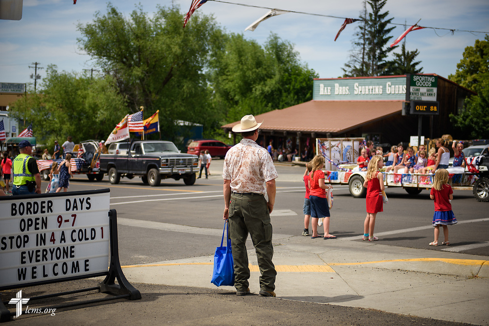 A man watches the Grangeville Border Days Independence Day celebration and parade on Tuesday, July 4, 2017, in Grangeville. LCMS Communications/Erik M. Lunsford