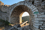 Canon in an arch in the entrance of the citadel or Berat Castle or Kalaja e Beratit, in Berat, South-Central Albania, capital of the District of Berat and the County of Berat. The canon dates to 1684 and is thought to be English. It may have been made by the British gunfounder Thomas Western (1624- 1707) and is a large saker, which fired a cast-iron solid shot. It is engraved with the lion of St Mark, the symbol of the Venetian republic, so it may have been captured in battle from Venice or acquired through trade. The castle dates mainly from the 13th century and contains Byzantine churches, Ottoman mosques and housing. It is built on a rocky hill on the left bank of the river Osum. Picture by Manuel Cohen