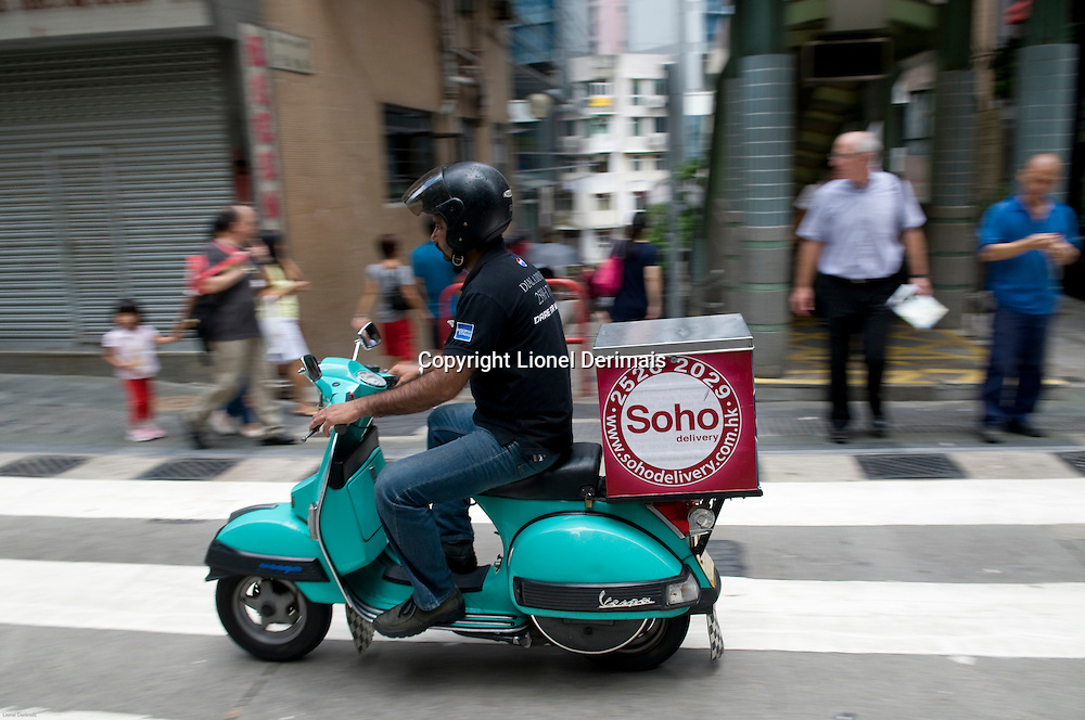Delivery by scooter, mid-levels, Hong Kong.