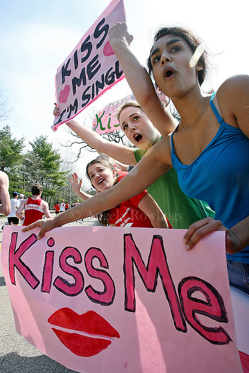 (042108  Wellesley, MA) Wellesley College sophomores Alyson Tocho, second from right, and Nisha Bedi, right, cheer on runners and offer kisses outside their school, Monday,  April 21, 2008.  photo by Angela Rowlings.