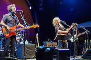 Bassist David Sutton, Lucinda Williams, and guitarist Stuart Mathis on stage at Celebrate Brooklyn.