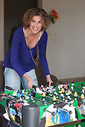 Young woman plays foosball (Table football)