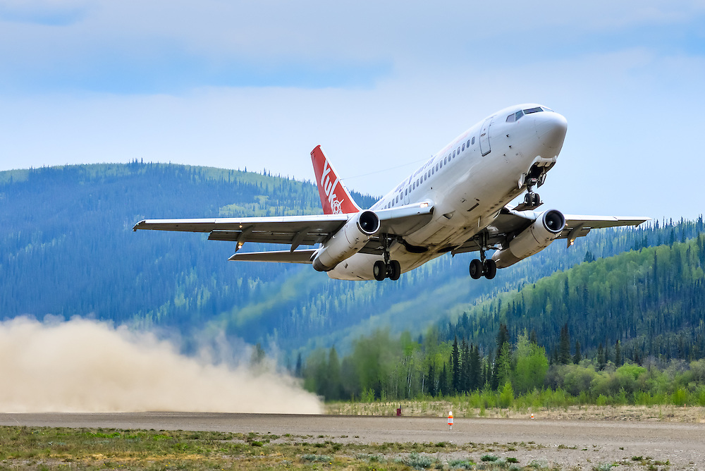 A gravel-kit equipped 737 taking off from the unpaved Dawson City runway