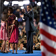 Sen. Barack Obama accepts his party's nomination as the Democratic candidate for President on the fourth day of the Democratic National Committee (DNC) Convention at Invesco Field in Denver, Colorado (CO), Thursday, Aug. 28, 2008.   Pictured are Michelle Obama and daughter Malia and Sasha...Photo by Khue Bui