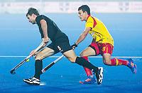 LUCKNOW (India) -   Junior World Cup hockey  U21 for men .  Spain v New Zealand. David Brydon (NZL) with Lucas Garcia Alcalde (ESP) . COPYRIGHT  KOEN SUYK