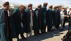 Taliban militants attend a surrender ceremony in Baghlan province, north of Kabul, Afghanistan on Jan. 13, 2013. A Taliban group composed of 14 fighters laid down arms and joined the government-backed peace process in Baghlan province on Sunday, January 13, 2013. Photo by Imago / i-Images...UK ONLY