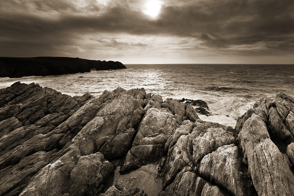 Eroded limestone cliffs jutting into the Irish Sea at Rhoscolyn Head, Holy Island, Anglesey.