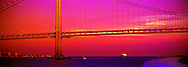 Verrazano Bridge at Sunset, Reflecting the Orange Glow of Light with Sea Channel Traffic