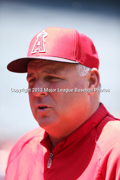 ANAHEIM, CA - JUNE 15:  Mike Scioscia #14 of the Los Angeles Angels of Anaheim chats during batting practice before the game against the New York Yankees on Saturday, June 15, 2013 at Angel Stadium in Anaheim, California. The Angels won the game 6-2. (Photo by Paul Spinelli/MLB Photos via Getty Images) *** Local Caption *** Mike Scioscia