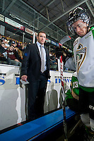 KELOWNA, CANADA - DECEMBER 6: Kelly Guard, assistant coach of the Prince Albert Raiders stands on the bench against the Kelowna Rockets on December 6, 2014 at Prospera Place in Kelowna, British Columbia, Canada.  (Photo by Marissa Baecker/Shoot the Breeze)  *** Local Caption *** Kelly Guard;