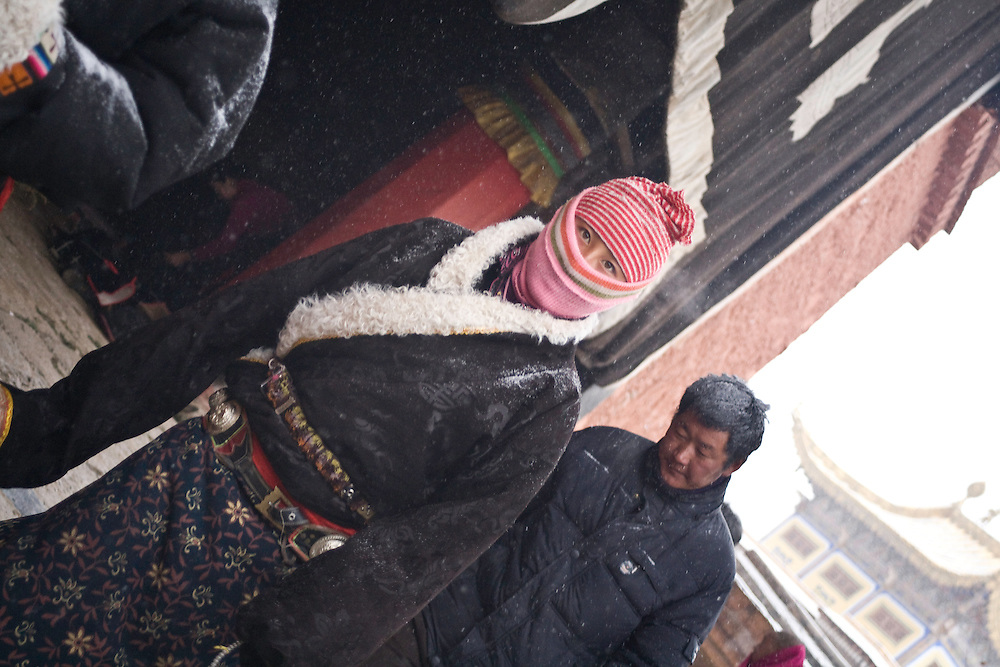A tibetan woman is following the circumambulation of the temple of Maitreya - the popular Buddha of the Future - in the monastery of Labrang. Pilgrims hope that he could bring a new historic cycle and give them a better reincarnation.