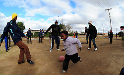 Local kids playing soccer in Rocklands a Township outside of Bloemfontein South Africa on 23 June 2009, during the 2009 Confederations cup in South Africa. Photo:Gerhard Steenkamp/Superimage Media