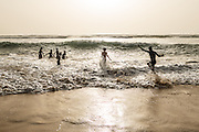 Cabo Verde, Boa Vista, young surfers along the beach