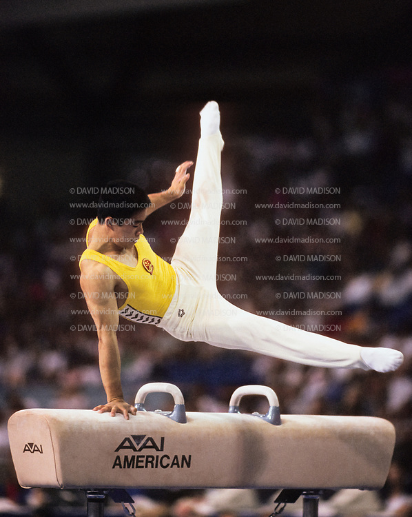 SEATTLE - JULY 1990:  Huang Huadong of China performs on the pommel horse during the Men's Gymnastics competition of the 1990 Goodwill Games held from July 20 - August 5, 1990.  The gymnastics venue was the Tacoma Dome in Tacoma, Washington.  (Photo by David Madison/Getty Images)