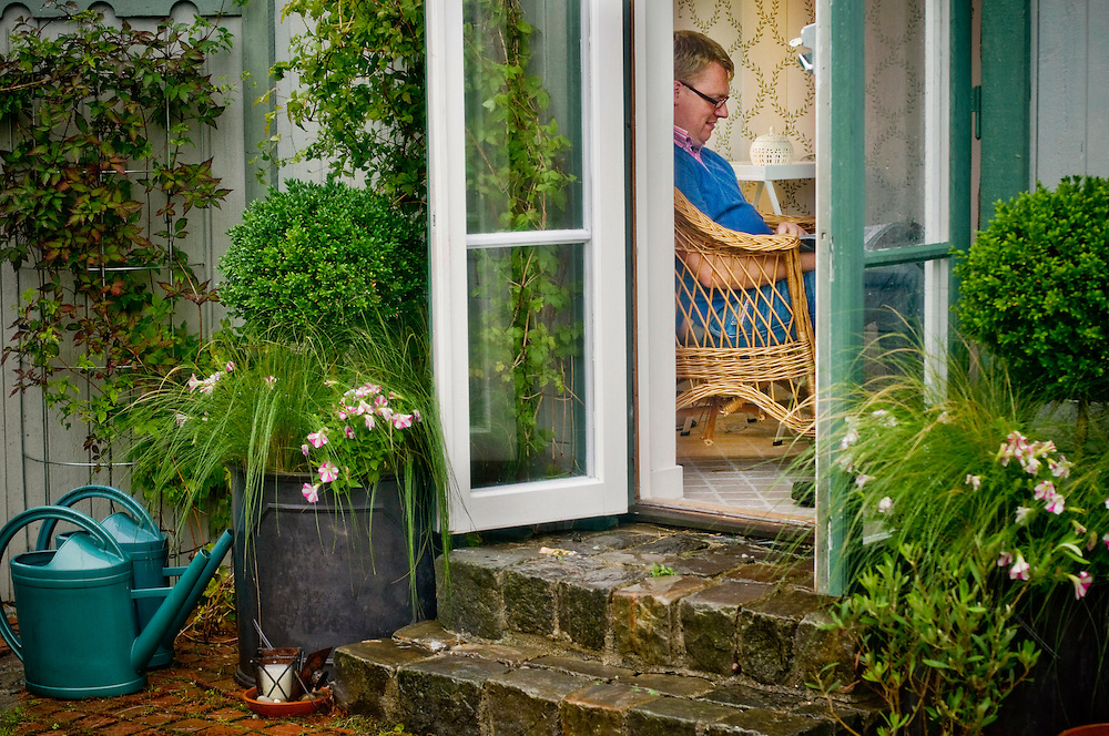 Måns Persson reading in his and Pernilla Cederlund's summer house in Vitaby, Skåne