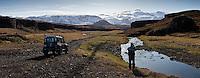 A man by his Land Rover Defender in Trollagja, near river Markarfljot. Glacier Eyjafjallajokull in background. <br /> <br /> Ferðamaður og Land Rover Defender í Tröllagjá, nærri Markarfljóti. Eyjafjallajökull í baksýn.
